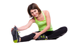 Sport woman stretching on the floor Stock Image