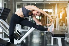 Sport woman stretching for warming up befor doing exercises training,Cross fit body muscular workout in the gym. Sport asian woman stretching for warming up royalty free stock photography