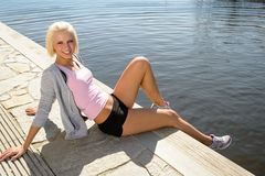 Sport woman summer relax water pier Stock Photography