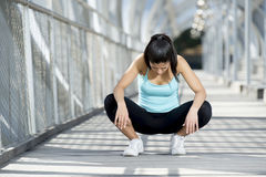 Sport woman tired and exhausted breathing and cooling down after running Stock Image