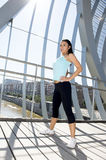 Sport woman tired and exhausted breathing and cooling down after running Royalty Free Stock Photos