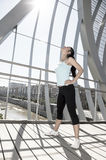 Sport woman tired and exhausted breathing and cooling down after running Stock Images