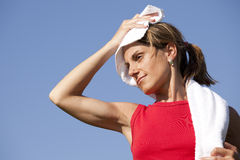 Sport woman with a towel Royalty Free Stock Images