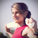 Sport woman with a towel. Woman cleaning her sweat with a towel Royalty Free Stock Images