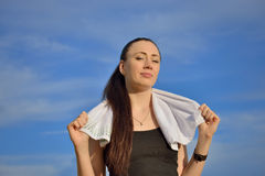 Sport woman with towel Stock Images