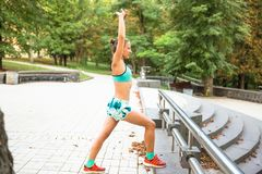 Sport woman training outside in city park . Fall time on street. Sport woman training outside in city park . Fall time on street stock photos