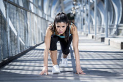 Sport woman training start up grid for running race in urban training workout. Young beautiful and athletic sport woman training start up grid for running race royalty free stock photos