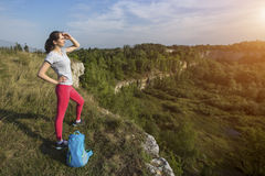 Sport woman traveler on the top of mountain. Royalty Free Stock Image