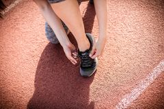Sport woman tying her shoe. Close up image. Royalty Free Stock Photo