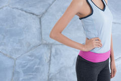 Sport woman with wall in background. Sport woman with a wall in background Stock Images