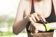 Sport woman wearing smart watch device with touch Stock Images