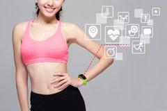 Sport woman wearing smart watch. Health sport woman wearing smart watch device with health icon isolated on gray background, asian beauty stock photos