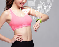 Sport woman wearing smart watch. Health sport woman wearing smart watch device with health icon isolated on gray background, asian beauty royalty free stock image