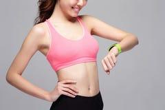 Sport woman wearing smart watch Royalty Free Stock Image