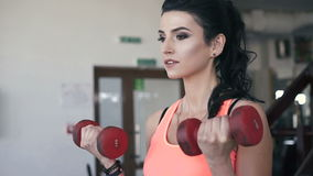 Sport woman weightlifting in the gym. Slowly stock video footage