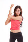 Sport woman working out her biceps arm muscle Stock Images