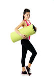Sport woman with yoga mat Royalty Free Stock Images