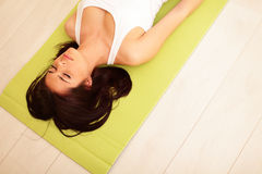 Sport woman on the yoga mat Stock Photography