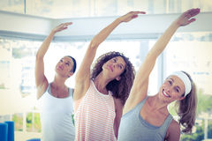 Sport women with arm raised Royalty Free Stock Photo