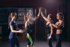 Sport women giving high five after training Stock Image