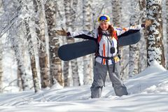 Sport women going for freeride with snowboard Stock Image