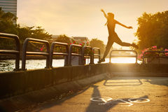 Sport women jumping on the bike lane in the sunrise, soft focus Stock Image