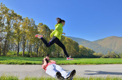 Sport women and men Royalty Free Stock Photography