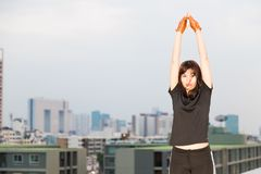 Sport women stretch working on the top of building twilight royalty free stock photos