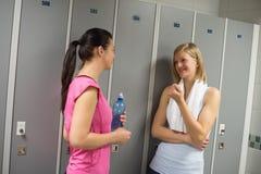 Sport women talking in locker room. At healthclub Royalty Free Stock Image