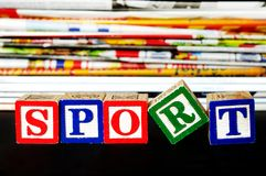 Sport word. Near many newspapers Stock Photography