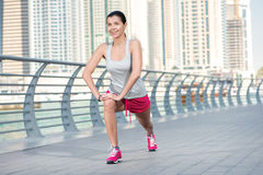 Sport workout. Athletic woman in sportswear doing sport exercise Royalty Free Stock Image
