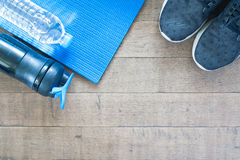 Sport and workout equipment on wood background. Flat lay of healthy lifestyle concept Royalty Free Stock Photos