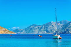 Sport yacht on anchor in bay of Greek Island Royalty Free Stock Photography