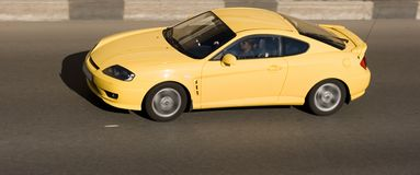Sport yellow car speed road. A car speed drive road: yellow bright, sportscar Royalty Free Stock Image