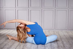 Sport yoga suit woman healthy. Blond woman gymnast athlete beautiful dressed in a special costume for fitness yoga sport clothing made of nylon, diet nutrition royalty free stock image