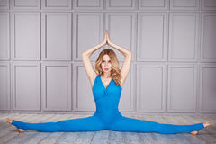 Sport yoga suit woman healthy. Woman gymnast athlete beautiful blonde dressed in a special costume for fitness yoga sport tight-fitting clothing made of nylon stock photos