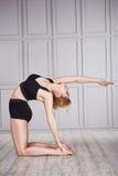 Sport yoga woman blond suit Stock Image