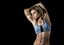 Sport, young fitness girl with slim muscular body posing in the Stock Photo