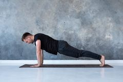Sport caucasian young man doing full plank. stock photos