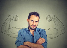 Sport young man with huge, fake, muscle arms drawn on the chalkboard Royalty Free Stock Images