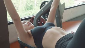 Sport young woman doing exercise with barbell on bench in fitness gym. People lifestyle and workout sport training healthy club. Activity concept. Bodybuilder stock video