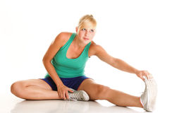 Sport Young woman doing exercise isolated on white Stock Photography