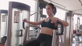 Sport young woman doing exercise with seated chest press in fitness gym. People lifestyle and workout sport training healthy club. Activity concept. Bodybuilder stock video