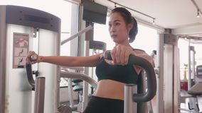 Sport young woman doing exercise with seated chest press in fitness gym. People lifestyle and workout sport training healthy club. Activity concept. Bodybuilder stock footage