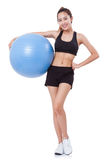 Sport young woman doing exercises with fitness ball. Stock Photo