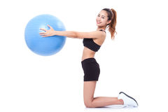 Sport young woman doing with fitness ball. Royalty Free Stock Photography