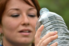 Sport young woman drinking water Stock Images