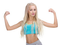 Sport young woman with perfect body showing biceps Royalty Free Stock Photo