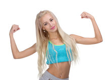 Sport young woman with perfect body showing biceps Royalty Free Stock Photography