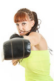 Sport young woman training in boxing gloves punching towards cam Royalty Free Stock Images